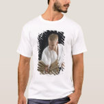 Young man breaking boards with karate chop on T-Shirt