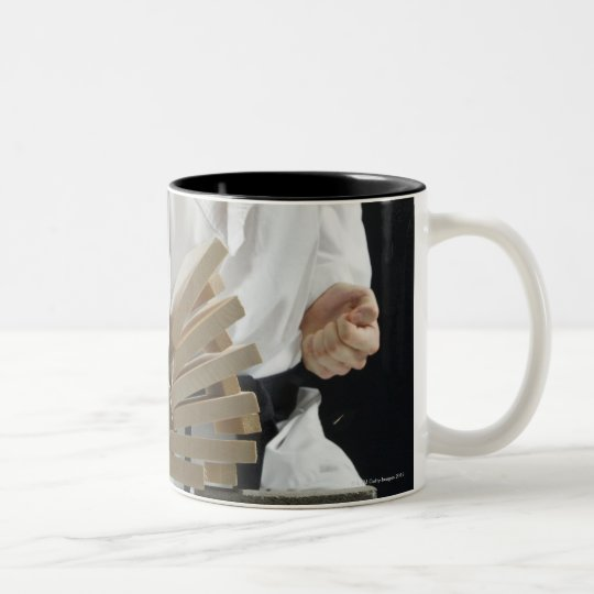 Young man breaking boards with karate chop on Two-Tone coffee mug