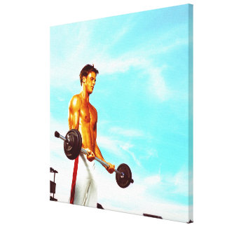 Young man exercising with barbells canvas print