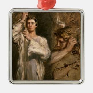 Young Man Holding a Cross Christmas Ornament