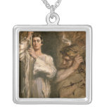 Young Man Holding a Cross Silver Plated Necklace