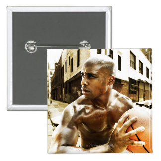 Young man holding basketball 15 cm square badge