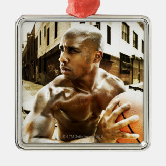 Young man holding basketball christmas ornament