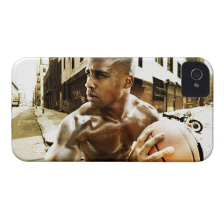 Young man holding basketball iPhone 4 Case-Mate case
