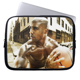 Young man holding basketball laptop sleeve