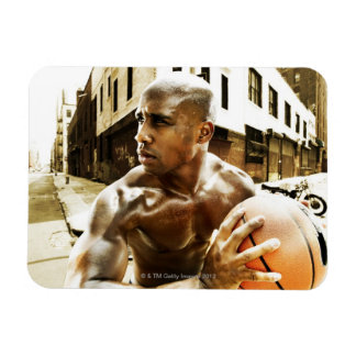 Young man holding basketball magnet