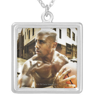 Young man holding basketball silver plated necklace