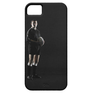 Young man holding rugby ball, portrait iPhone 5 cover