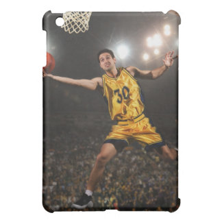 Young man jumping and holding basketball iPad mini cover