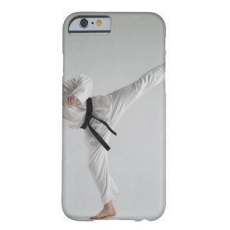 Young man performing karate kick on white barely there iPhone 6 case