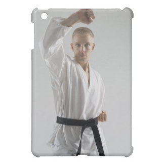 Young man performing karate stance on white cover for the iPad mini