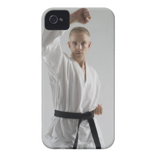 Young man performing karate stance on white iPhone 4 Case-Mate case