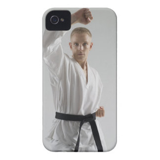 Young man performing karate stance on white iPhone 4 covers