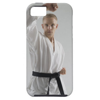 Young man performing karate stance on white iPhone 5 covers