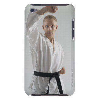 Young man performing karate stance on white iPod touch covers