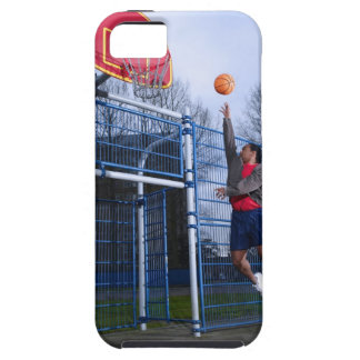 Young man playing basketball outdoors case for the iPhone 5