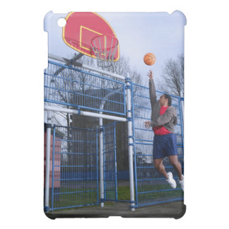 Young man playing basketball outdoors iPad mini case