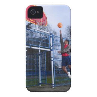 Young man playing basketball outdoors iPhone 4 Case-Mate case