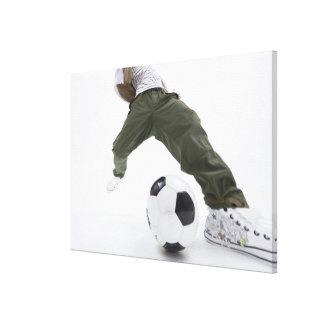 Young man playing soccer 2 canvas print