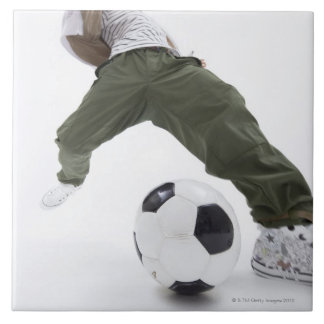Young man playing soccer 2 large square tile