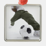 Young man playing soccer 2 ornaments