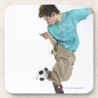 Young man playing soccer coaster