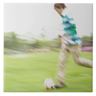 Young Man Playing Soccer Large Square Tile