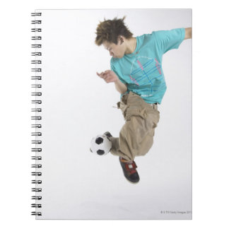 Young man playing soccer notebook
