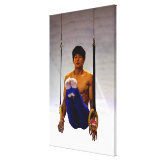 Young man practicing gymnastic rings canvas print