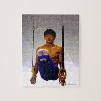 Young man practicing gymnastic rings jigsaw puzzle