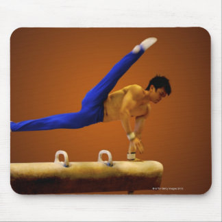 Young man practicing gymnastics on the pommel mouse pad