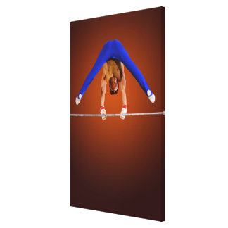 Young man practicing on the horizontal bar canvas print