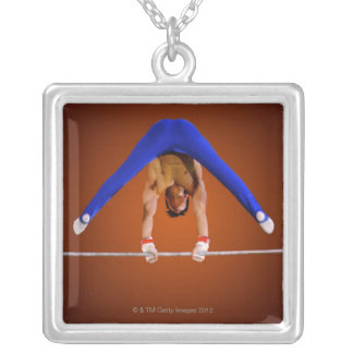 Young man practicing on the horizontal bar silver plated necklace