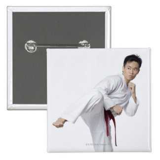 Young man practicing side kick 15 cm square badge