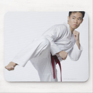 Young man practicing side kick mouse pad