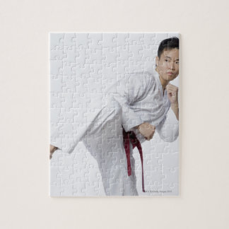 Young man practicing side kick puzzle