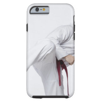 Young man practicing side kick tough iPhone 6 case