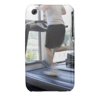 Young man running on a treadmill at health club, iPhone 3 cases