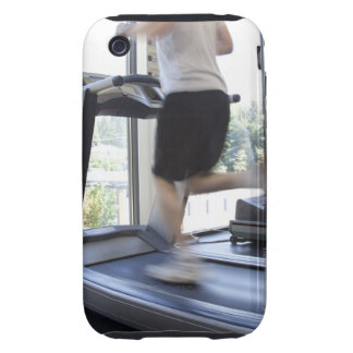 Young man running on a treadmill at health club, iPhone 3 tough cover