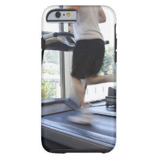 Young man running on a treadmill at health club, tough iPhone 6 case