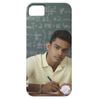 young man sitting at his desk, writing iPhone 5 case