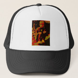 young man sitting on a garden wall trucker hat