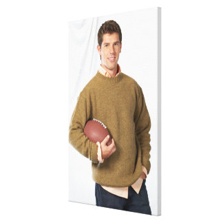 Young man with a football canvas print
