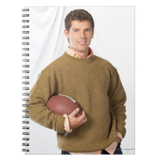 Young man with a football spiral notebook