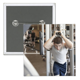 Young man working out his triceps on a cable 15 cm square badge