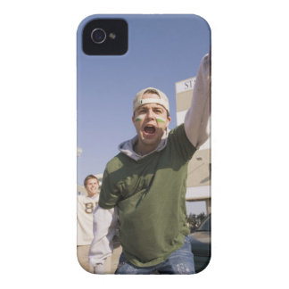 Young men cheering in parking lot before game iPhone 4 Case-Mate cases
