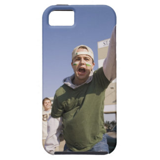 Young men cheering in parking lot before game iPhone 5 cover