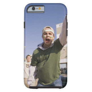 Young men cheering in parking lot before game tough iPhone 6 case