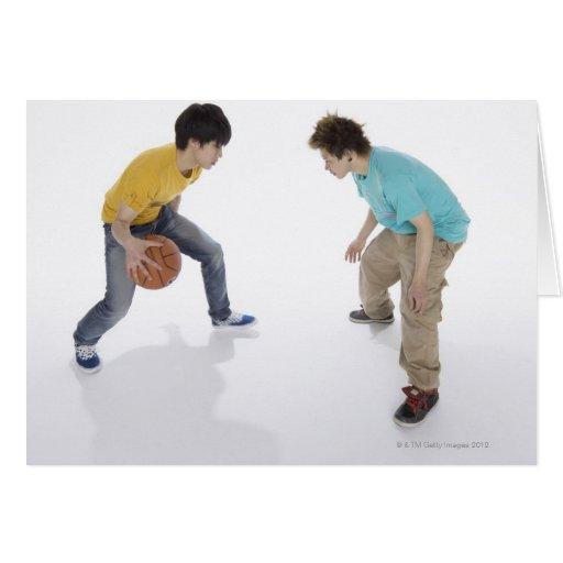 Young men playing basketball greeting card