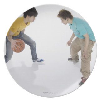 Young men playing basketball plate